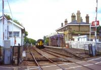 Overlooked by the East Suffolk Line's RETB signalling centre on the left, a Class 153 waits to depart from Saxmundham as the 17.09 to Ipswich on 15th June 2011. <br> <br><br>[David Spaven&nbsp;15/06/2011]
