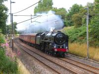 Running south towards Barton and Broughton on the WCML on 15 August 2011, Britannia Pacific no 70013 <I>Oliver Cromwell</I> makes easy work of <I>The Mersey Moorlander</I> with its 12 coach load. <br><br>[John McIntyre&nbsp;15/08/2011]