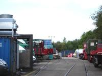 Photograph taken in July 2011 showing the entrance lines from Network Rail into the former Procor, later Bombardier, railway works at Horbury Junction, Wakefield. The picture shows the later arrangement of three access tracks to cope with the volume of Virgin Mk 2 and then GNER Mk 4 stock refurbished here prior to closure by Bombardier.<br><br>[David Pesterfield&nbsp;06/07/2011]