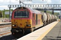 67030 passing through Cardonald on 23 June with a short consist of tanks from Mossend to Dalry<br><br>[Graham Morgan&nbsp;23/06/2011]