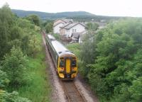The 1236 service from Wick (and Thurso) departs from Alness and heads for Dingwall. This photograph of unit 158709 was taken from the academy footbridge that spans the line at the station and offers this view to the south. <br><br>[Mark Bartlett&nbsp;29/06/2011]