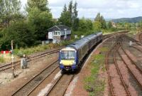 A southbound service in the hands of 170428 passes Stirling North <br> signal box on the approach to Stirling station on 20 August 2011. <br> <br><br>[John McIntyre&nbsp;20/08/2011]