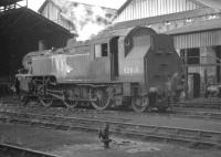 BR Standard class 3 2-6-2T no 82018 on shed at Nine Elms in October 1964.<br><br>[K A Gray&nbsp;23/10/1964]