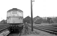 A fireman poses for the camera beside a BRCW Type 2 on the Down side of St Margarets shed on a Summer day in 1966. A 2-6-4 tank is simmering in the background and a diesel shunter can just be seen on the Up side, beyond the running lines of the ECML.<br> <br><br>[David Spaven&nbsp;//1966]