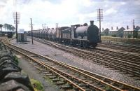 Polmont shed's J35 0-6-0 no 64531 brings a tank train east through Saughton Junction in July 1959. <br><br>[A Snapper (Courtesy Bruce McCartney)&nbsp;18/07/1959]