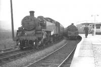 BR Standard class 3 2-6-2T no 82005 with a train at Dovey Junction in August 1962.<br><br>[K A Gray&nbsp;14/08/1962]