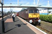 Having just arrived in Stirling station from the south sidings on 20 August, 47804 stands at platform 10 with the stock of the <I>Edinburgh Military Tattoo Statesman</I> railtour.<br><br>[John McIntyre&nbsp;20/08/2011]