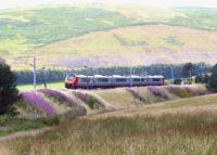 The 1400 Glasgow Central - Birmingham New Street Virgin Voyager heading south through the Clyde Valley on 5 August 2009 between Abington and Crawford.<br><br>[John Furnevel&nbsp;05/08/2009]
