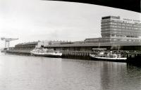 <I>Queen Mary II</I> at Stobcross in 1977, with her masts shortened to allow her  under the Kingston Bridge up to Bridge Wharf. Nearest the camera is MV <I>Queen of Scots</I>, chartered by the <I>Waverley</I> operators to cover for her during repair work following her contretemps with the Gantocks.<br><br>[Colin Miller&nbsp;//1977]