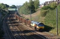 Colas Rail Freight no 66850 heads south on the up fast approaching <br> Farington Curve Junction on 22 August 2011 with the Carlisle to Chirk log train. <br> <br><br>[John McIntyre&nbsp;22/08/2011]