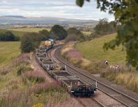 DRS 66424 heads a train of flats towards Grangemouth, just north of Greenfoot on 29 August 2011.<br> <br><br>[Bill Roberton&nbsp;29/08/2011]