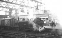 Steamed fish. The Carlisle station pilot, <I>Jinty</I> 0-6-0T no 47667, creates a bit of an atmosphere as it shunts a fish van in the station on 7 December 1963.<br><br>[K A Gray&nbsp;07/12/1963]