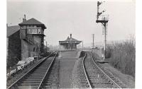 View west at Dumbarton East station and Dumbarton Goods Junction signalbox in April 1958. The distant building on the left beyond the box is Dumbarton shed, a subshed to Dawsholm, to the left of which was the approach to Dumbarton East Goods, the shed being reached by reversal from the goods yard.<br><br>[G H Robin collection by courtesy of the Mitchell Library, Glasgow&nbsp;12/04/1958]