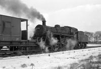 BR Standard Class 3 2-6-0 no 77002 shunts the goods yard at Duns on a snowy but bright 1st March 1965 while managing to stay on the rails. The turnout where both 61116 and D181 came unstuck is just off picture to the right. <br> <br><br>[Bill Jamieson&nbsp;01/03/1965]