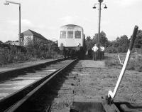The BLS 'Forth Fife Railtour' on the Alloa Harbour branch on 28 August 1976. View is north, looking back towards Bedford Place, with the Glasshouse Loan Centre (music project and workshop) standing on the left. [Editors note: In response to queries re the dmu destination of 'Cluny Bridge' Bill tells me that, according to 'folklore', when destination blinds were being ordered for dmus, Cluny Bridge showed up in the working timetable (as an ecs destination) so was added to the menu!]<br><br>[Bill Roberton&nbsp;28/08/1976]