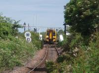 The Kessock Bridge almost frames 158720, as it negotiates the 10mph Clachnaharry swing bridge while heading west on a Kyle line service on 1 July 2011. This view was taken from the beer garden of the Clachnaharry Inn at the site of the long closed station. <br><br>[Mark Bartlett&nbsp;01/07/2011]