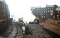 A Black 5 storms out of Edinburgh's Princes Street station with the 1.20 pm service to Lanark on 2nd November 1964. Nowadays this view - from Grove Street towards Morrison Street - is dominated by the Western Approach Road, but the tenements in the middle distance and the 'colonies' to the right still survive. [See image 18413]<br><br>[Frank Spaven Collection (Courtesy David Spaven)&nbsp;02/11/1964]