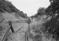 A photograph taken on the BLS 'Forth Fife Railtour' of 28 August 1976 showing the buffer stop on the truncated Kirkliston branch,<br> looking back north towards the main line and the connection into MOD Royal Elizabeth Yard, Dalmeny.<br> <br><br>[Bill Roberton&nbsp;28/08/1976]