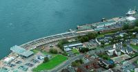 Alterations to Gourock station seen in an aerial view on 29 August 2011. The trainshed canopy has been cut back to the circulating area and the remaining section re-glazed. A new station building has been built by the trainshed.<br><br>[Ewan Crawford&nbsp;29/08/2011]