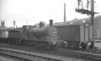 Aspinall 3F 0-6-0 no 52466 stands with a freight at signals at Oldham Mumps in May 1960.<br><br>[K A Gray&nbsp;20/05/1960]
