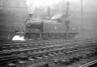 C16 4-4-2T no 67492 adding to the haze hanging over St Margarets shed on 6 September 1958. The locomotive took charge of that days SLS <i>Lothian Lines Tour</i> from Edinburgh Waverley, visiting various locations in Edinburgh and the Lothians.<br><br>[Robin Barbour Collection (Courtesy Bruce McCartney)&nbsp;06/09/1958]