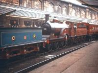 The preserved Samuel Johnson Midland Railway <I>'Spinner'</I> no 118 (later no 673), now a static exhibit at the NRM, photographed at Carlisle station during an exhibition of vintage locomotives and rolling stock that took place in June 1958. <br> <br><br>[A Snapper (Courtesy Bruce McCartney)&nbsp;16/06/1958]