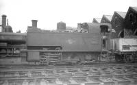 Collett 0-4-0T dock shunter no 1103, built by the Avonside Engine Co, Bristol, in 1926 and spending most of its life in and around Swansea docks. Seen here on its home shed at Danygraig (87C) in June 1959, six months before withdrawal. Note the bell mounted on the front of the cab.<br><br>[Robin Barbour Collection (Courtesy Bruce McCartney)&nbsp;28/06/1959]