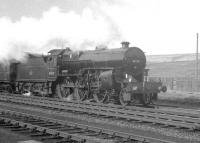 Crab 2-6-0 no 42737 at Beattock Summit on 29 March 1964 with <I>Scottish Rambler no 3</I>. The railtour was on its way to Beattock station where it would hand over to 80118 for a visit to the Moffat branch. [See image 21122]<br><br>[K A Gray 29/03/1964]