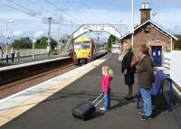 The 1155 hrs from Helensburgh Central to Edinburgh arrives at Cardross on 4 September 2011 to collect at least some of the passengers waiting on the platform. <br> <br><br>[John McIntyre&nbsp;04/09/2011]