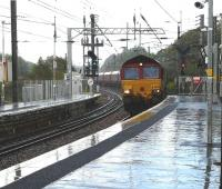 DBS 66221 with the early running 4J74 Cockenzie power station  - Hunterston import terminal, runs through Kilwinning station on 7 September in atrocious weather conditions!<br><br>[Ken Browne&nbsp;07/09/2011]