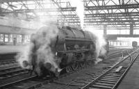 Shrouded in steam, Royal Scot 4-6-0 no 46152 <I>The King's Dragoon Guardsman</I> waits patiently on the centre road at Carlisle on 23 January 1965. The Scot had recently arrived from Kingmoor shed and was waiting to relieve the locomotive off the 9.25am Crewe - Perth train.<br><br>[K A Gray&nbsp;23/01/1965]