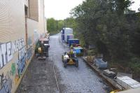 All that remains of Abbeyhill Station, seen looking south from London Road on 6 September 2011, with the site now in use as a work compound. Track is still in place, but is largely buried by infill, while the up platform makes a useful storage area. [See image 22469]<br><br>[Bill Roberton&nbsp;06/09/2011]