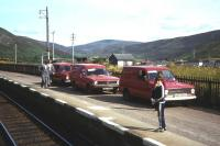 As late as 1983, as many as three Royal Mail vans wait for the train from Inverness at Helmsdale.<br><br>[Frank Spaven Collection (Courtesy David Spaven)&nbsp;//1983]