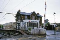 This was the main station in Balloch until 1988 when a new structure was opened on the opposite side of the level crossing [see image 4739]. The relocation became feasible after the extension north to the pier station closed in September 1986, saving all the costs associated with the level crossing and maintenance of the elderly building (now preserved).<br><br>[Mark Dufton&nbsp;27/05/1985]