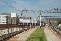 Looking across to the LNWR lines from Ardwick's deserted platforms, situated on the old Great Central route. Northern EMU 323237 is approaching Ardwick junction (where the two companies met) on a suburban service for Manchester Piccadilly. <br><br>[Mark Bartlett&nbsp;03/08/2011]