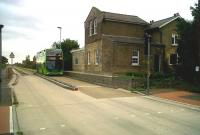 This station, on the former Huntingdon-Cambridge line, has been converted to a private home named 'Gresley House'. The whirring sound you hear is Sir Nigel himself, spinning in his grave, as a double decker bus heads for Cambridge on 10 September along the new Guided Busway.<br><br>[Ken Strachan&nbsp;10/09/2011]