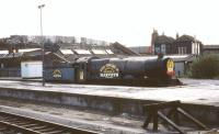Ex-GWR King class locomotive no 6023 <I>King Edward II</I>, stabled in 'rescued' condition at Bristol Temple Meads station in May 1985. The banner proclaims that the locomotive is to be restored with the help of a Bristol based company renowned for its sherry.<br> <br><br>[John McIntyre&nbsp;/05/1985]