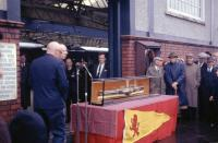 A ceremony taking place at Gourock on 31 May 1969 with the presentation of a model of a steamer from the Caledonian Steam Packet Company. In the background a Blue Train stands at the platform and behind the camera is TS <I>Duchess of Hamilton</I> on a charter to Brodick via the Kyles of Bute.<br> <br><br>[John McIntyre&nbsp;31/05/1969]