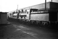 A pair of J36 0-6-0s, nos 65253 + 65323, standing alongside Dunfermline shed on a quiet looking Wednesday afternoon in February 1959.<br><br>[Robin Barbour Collection (Courtesy Bruce McCartney)&nbsp;11/02/1959]