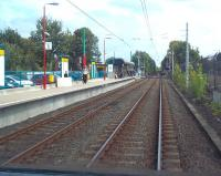 Photograph taken from the rear of a Metro service departing from Fawdon for Newcastle Airport on 10 September 2011. The train has just left from the staggered platform on the far side of the level crossing - the Newcastle bound platform stands on left. [See image 21036]<br><br>[Andrew Wilson&nbsp;10/09/2011]