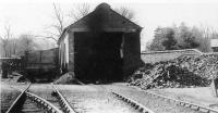 The hospital railway engine shed at Whittingham, pictured some time in the 1950s. The resident locomotives are not to be seen in this view but a wooden bodied coal wagon stands alongside. After the 1957 line closure the shed lived on and is still in use in 2011 as an NHS workshop. [See image 35695]. <br><br>[David Hindle Collection&nbsp;//]