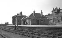 Summer of 1966 at Lossiemouth station, two years after closure. As the photographer's friend, David Fasken recollects, <I>I remember that it was absolutely intact in every way and it brought the 'Marie Celeste' to mind. Inside the booking hall it looked as if the staff had received a phone call and had simply got up and left.</I> <br><br>[David Spaven&nbsp;//1966]