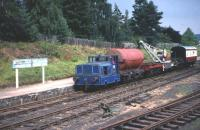 A PW train departs from Boat of Garten in August 1975 to carry out some re-sleepering work towards Aviemore. The loco is the ex Aberdeen Gas Board Simplex 4w DM shunter No 1D, at that time still in Gas Board blue livery. <br> <br><br>[John McIntyre&nbsp;/08/1975]
