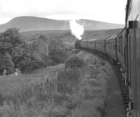Black 5 no 44785 heads south from Kildonan on 7 September 1960 with the afternoon train from Wick to Inverness. The photographer had joined the train at Georgmas Junction, having arrived there off an earlier connection from Thurso [see image 28876].<br><br>[K A Gray&nbsp;07/09/1960]