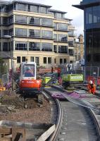New tram rails being laid through Haymarket Yards on 20 September 2011. View north east towards Haymarket Terrace. [See image 29758]<br><br>[Bill Roberton&nbsp;20/09/2011]