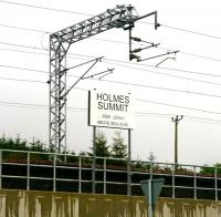 The new summit-board near Forrestfield on the Airdrie-Bathgate route named after the late Derek Holmes. Born in Dundee in 1959, Derek began his railway career as a signalman in the Dundee area. At the point of his untimely death in January 2010 he held the position of Production Director with Network Rail, as well as being chairman of the Institution of Railway Operators.<br> <br><br>[John Furnevel&nbsp;19/09/2011]