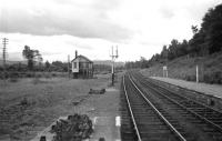 Looking past the abandoned Boat of Garten West signal box in the Summer of 1966. The shiny line to the left carried the remaining daily Speyside goods over the extended 14� mile block section from Aviemore to Grantown-on-Spey (East) until final closure in late 1968.<br> <br><br>[David Spaven&nbsp;//1966]