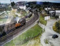 A freight approaches Totnes from the west. This photograph is on the wall of the office in TTS Tyre Services nearby the station - many thanks for allowing me to photograph it. Photographer and date unknown.<br><br>[Ewan Crawford&nbsp;//]