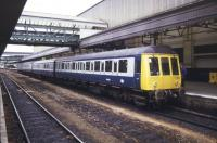 The 07.10 DMU from Barnstaple arrives at Exeter St Davids on 9 May 1985 complete with attached GUV.<br><br>[Ian Dinmore&nbsp;09/05/1985]