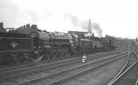Britannia Pacific no 70023 minus its <I>Venus</I> nameplate, together with a selection of other ex-works locomotives heading through Doncaster station on 8 July 1961 on their way to 36A shed. <br><br>[K A Gray&nbsp;08/07/1961]